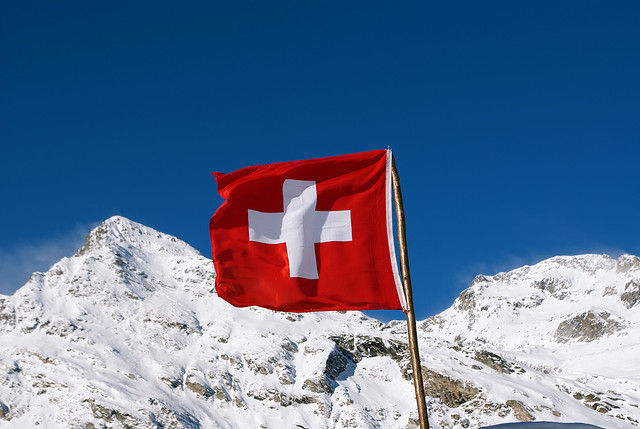 Swiss Flag before Mountains